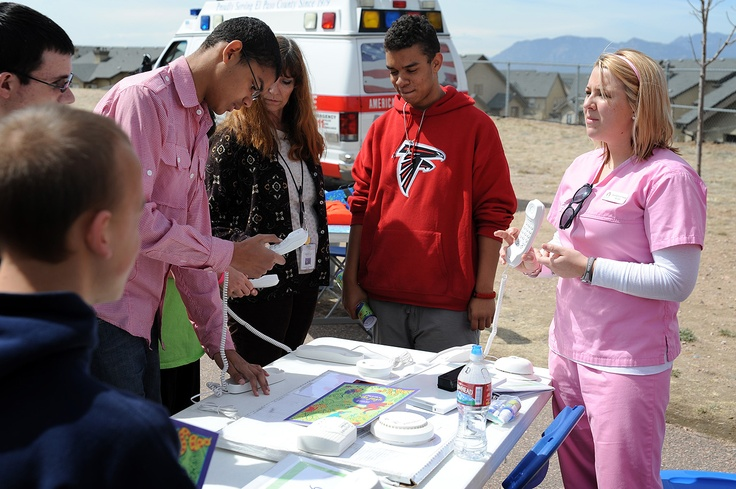 Ninth grader Justone Killett, 15, discusses emergency phones calls with school nurse Julie Schortmann during safety activities April 25 at Springs Ranch Elementary School in Falcon School District 49. Killett was visiting with other students in the Mild/Moderate Needs Program at Falcon High School. The educational activities were delivered by the Junglemobile from Children's Hospital Colorado in Denver.