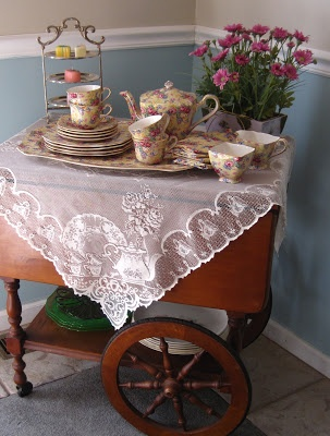 Lovely tea cart display. Would be amazing for a vintage tea party.