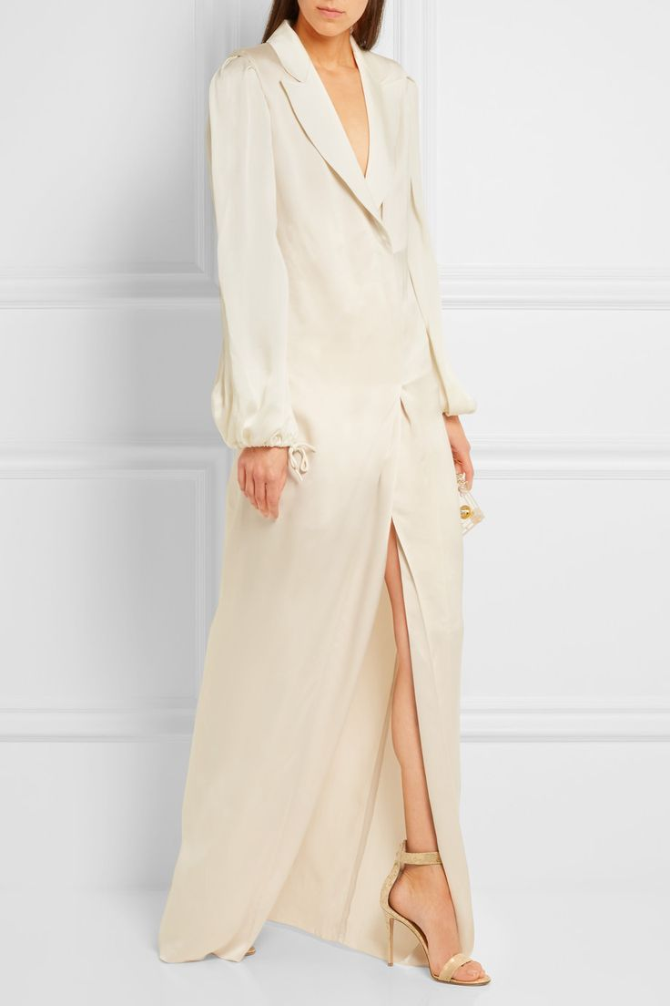 Lanvin's gown is an effortless choice for evening events. This ivory washed-twill design skims over your figure creating a beautiful drape and has a plunging V-neckline. The deep front split is perfect for showing off statement sandals.   Shown here with: Lanvin Blouse, Charlotte Olympia Clutch, Gianvito Rossi Sandals, Dolce & Gabbana Belt, Jennifer Fisher Cuff, Maria Black Ring.