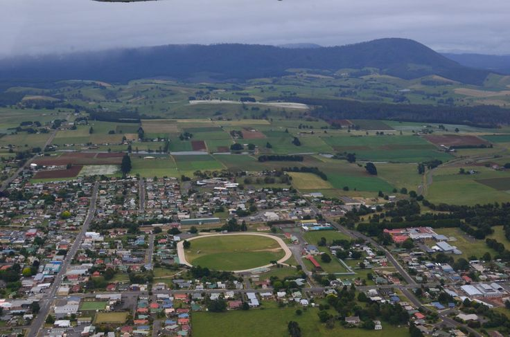 An arial view of part of Scottsdale township, hub of Dorset in North East Tasmania.  The white paddocks in the background are poppy crops grown for medicinal processing.