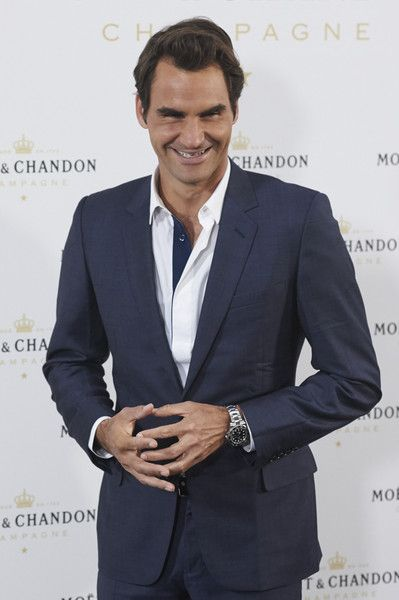 May 2015 Taking care of some of his sponsors: Fan fav for last 12 years, Roger is Moet's Global Spokesperson. Also notice Rolex watch that is shown, anotherc very  happy sponsor. Roger Federer Photos - 'Moet Tiny Tennis' in Madrid - Zimbio