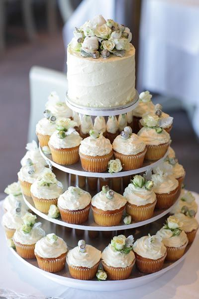 A British couple chose vanilla and lemon cupcakes from Brides in Bloom, decorated with roses and gum nuts to mix their heritage with Australia.  Image by Sugarlove weddings.