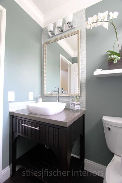 guest bathroom downstair. Framed mirror and backsplash to the ceiling.