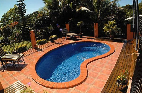 Appealing kidney shaped above ground pool in orange decks - Kidney shaped above ground swimming pools ...