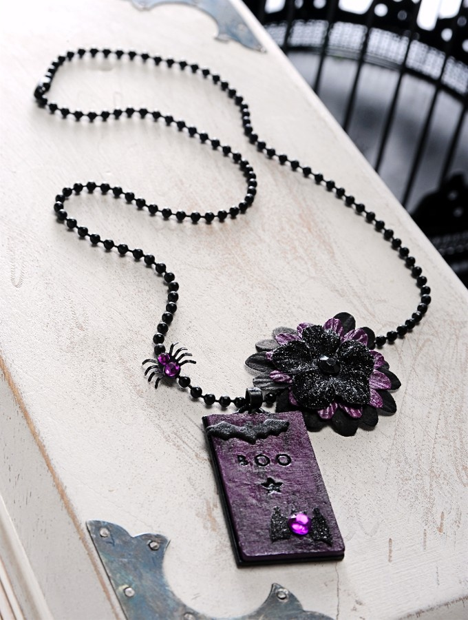 """This crafty """"boo"""" necklace is a great idea for Halloween - easy to make with paint and Mod Podge."""