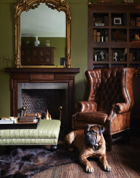 Classic room with a fireplace, a sofa chester years 60. The dog is a guard in this beautiful room. #interior #detailing #classic #chester #sofa #dog