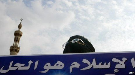 """Muslim Brotherhood supporter holds a banner saying: """"Islam is the solution"""" (2005)---- These people are in charge in Egypt and want to spread their rule across the Middle East They aren't shy about sharing this info."""