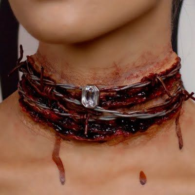 Nothing will say statement accessory this Halloween like a choker made of barbed wire, set against a bloody neck. Ouch! See this video tutorial on this elegant-gone-gory look.