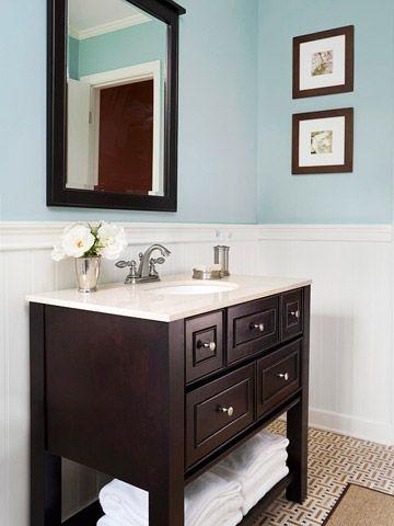 Great vanity idea for our teeny bathroom. Like the towel storage underneath