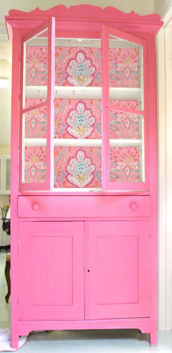 pink armoire - Put a favorite piece of fabric in the back, paint a coordinating color, and you have an awesome place to store fabric and projects!