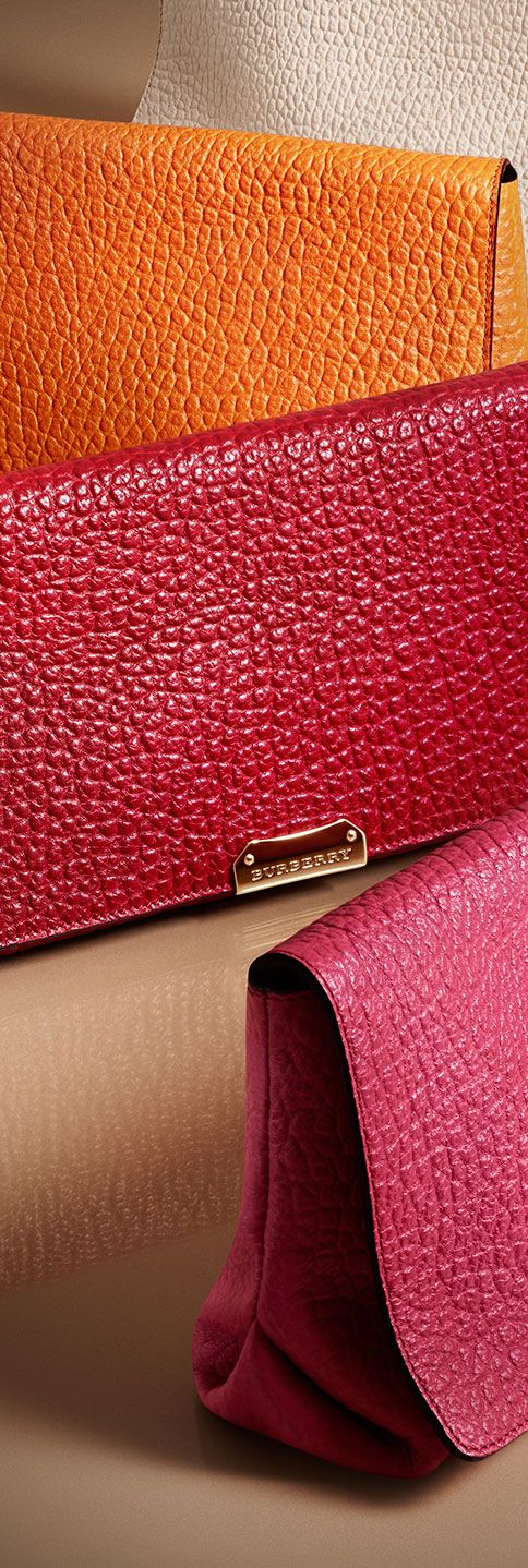 Grainy leather clutch bags in bright pops of colour.  Explore Valentine's gifts for her from Burberry