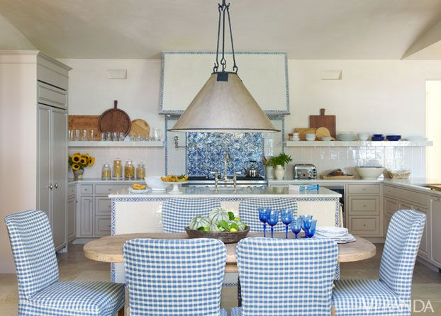 Limestone floor, blue accent upholstery (these by Rose Tarlow Melrose House), great ceiling fixture by Dessin Fournir