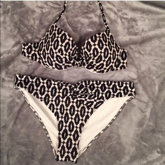 H&M Black and White Bikini Bottom Perfect condition! Worn once. Bottoms are a size 10 BUT they fit the same as a large. Swim Bikinis