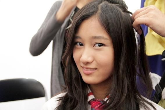 Rena Preparing Her Hair Before a Show.