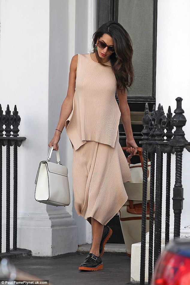 Amal Clooney shows off her chic sense of style in pretty pink #dailymail