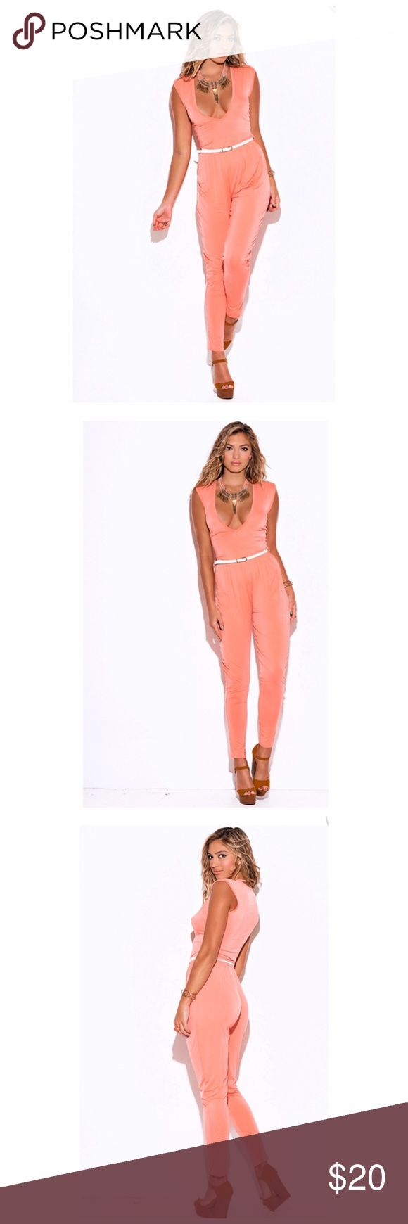 Sexy coral belted jumpsuit Cute Jumper good for the girl on the go! Features deep v neckline and belt. Also available in black.   Model wearing size small.  95% Rayon, 5% Spandex. Pants Jumpsuits & Rompers