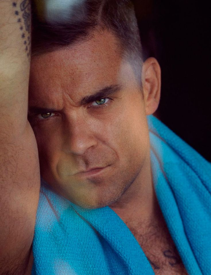 Robbie Williams photographed by Sean and Seng for the cover story of Interview Germany magazine's October 2012 issue.