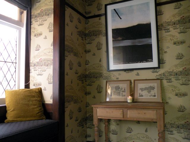 Wallpaper inspiration came from the prints on the table. Interior Design by Room Service Interiors.