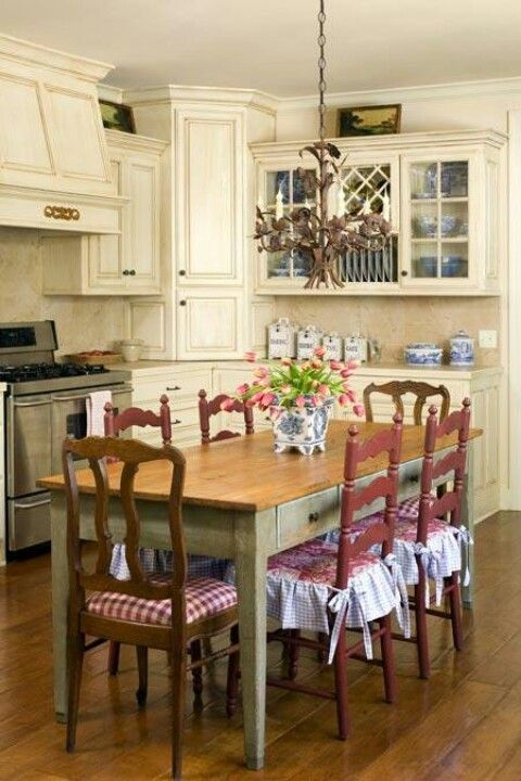 french country kitchen my dream! I dont like white cabinets because they are a pain to keep clean but I love the lighted glass cabinets the green blue and red!