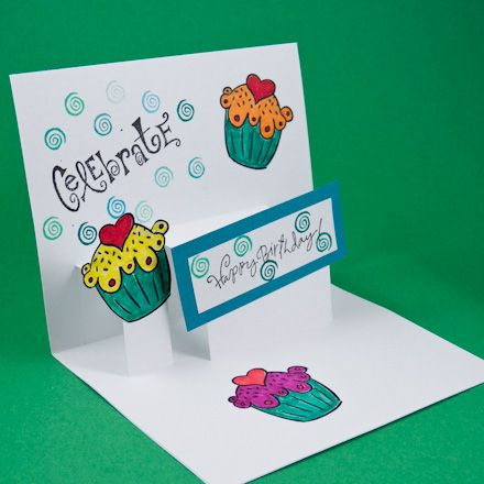 This greeting card tutorial features a pop-up greeting card for a variety of occasions. See how easy it is to make a step pop-up mechanism, also sometimes called a platform or double-slit pop-up. Once you learn this technique it's a simple matter to create pop-up cards of your own design.