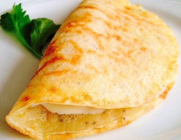 Crepioca funcional com ricota temperada.  Ingredientes  1 ovo2 col. (sopa) de goma de tapioca1 col. (sopa) de ricota temperada com azeite de oliva e orégano  Modo de fazer Acrescente o ovo à massa de  tapioca e, em seguida, adicione a ricota. Sirva.