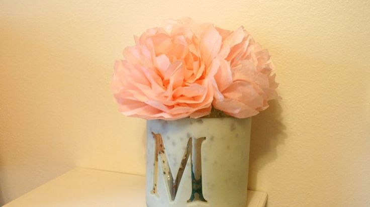I turned some used tissue paper from baby shower gifts into beautiful and delicate peony flowers! Easy and quick and can be made to match any room's decor!