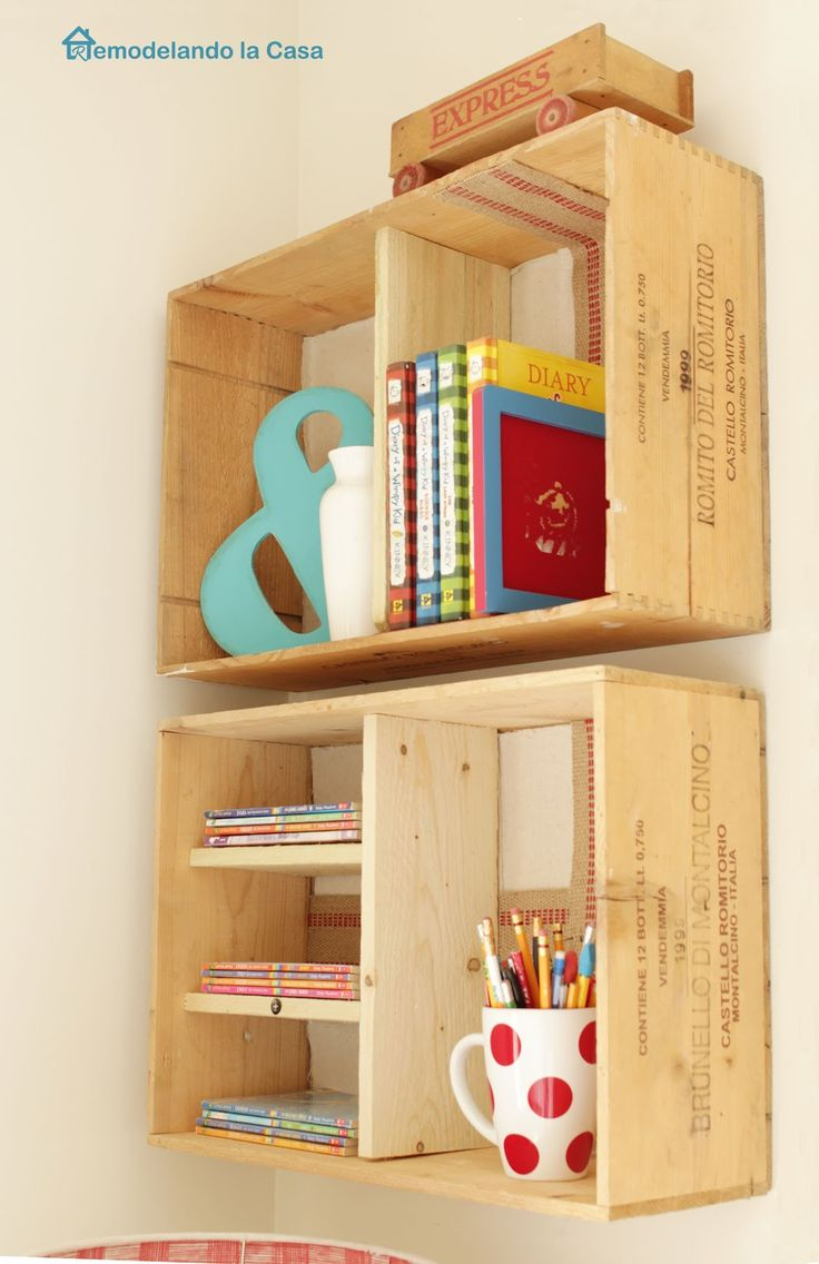 Wine creates repurposed as shelves. Wooden divisions help utilize their storage space in a better way