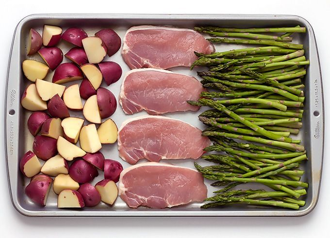 Sheet Pan Baked Parmesan Pork Chops Potatoes & Asparagus is a simple meal that comes together on one baking sheet and is packed with flavor.