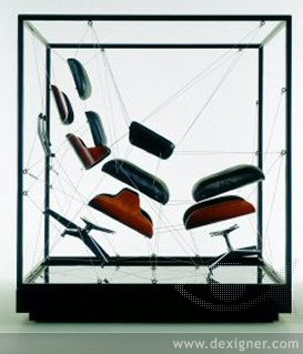 "Charles and Ray Eames, Lounge Chair and Ottoman, designed 1956,   ""Component Blowup"" for design installation 2005. Molded plywood, black leather upholstery, aluminum  Designed by Vince Faust, INvironments  Herman Miller, Inc."