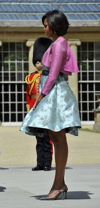 First lady Michelle Obama awaits a tour of the Queen's Gallery at Buckingham Palace in London, May 24, 2011.
