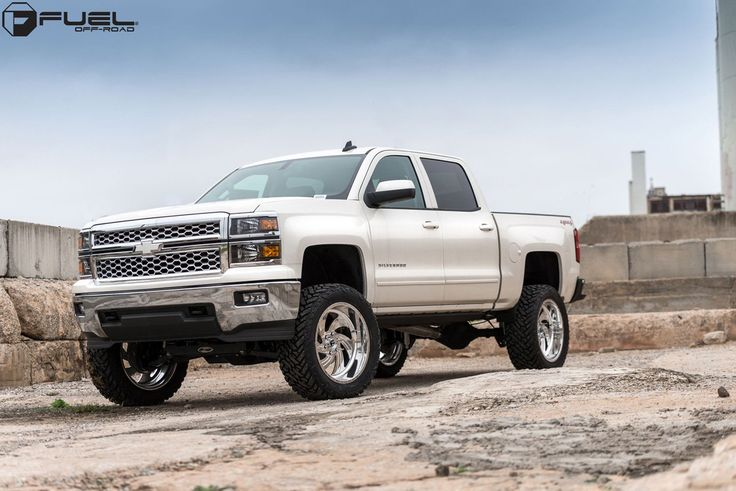 This white 2015 #Chevrolet #Silverado was taken to the next level thanks to a new lift kit and Fuel Wheels. The entire chassis sits a full 6.0 inches higher off the ground thanks to a Procomp lift kit. The kit not only allows for more ground clearance, but also allows for greater amounts of suspension travel. The new Fuel FF10 wheels also have more room to roll as well. http://www.wheelhero.com/rims-and-tires