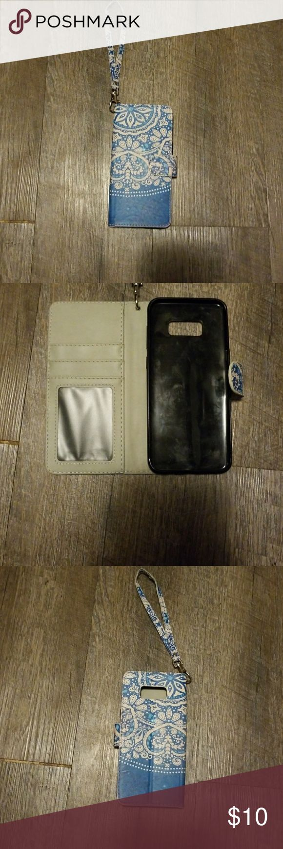 Wallet phone case Samsung Galaxy S8plus Cute blue and with pattern wallet phone case for a Samsung Galaxy s8 plus. Has a wrist attachment that clips on or off, magnetic latch, slits for cards and money, also turns into a phone stand. I've had this case for about 3 weeks. I just got an Otter box is the only reason I'm selling. Accessories