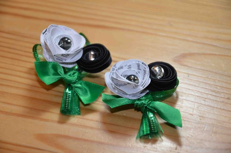 Paper mini boutonnieres with kelly green ribbon available from AJ's Craft Creations. https://www.facebook.com/ajs.craft.creations