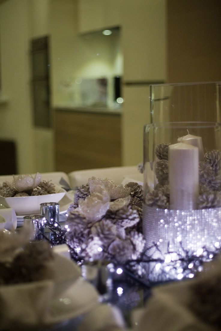 These place settings at our show home at The Lanes, Broadbridge Heath make it the ideal area to entertain this Christmas. The fairy lights on the table reflect the sparkly centerpiece beautifully and the frosted pine cones are an effective yet inexpensive touch.