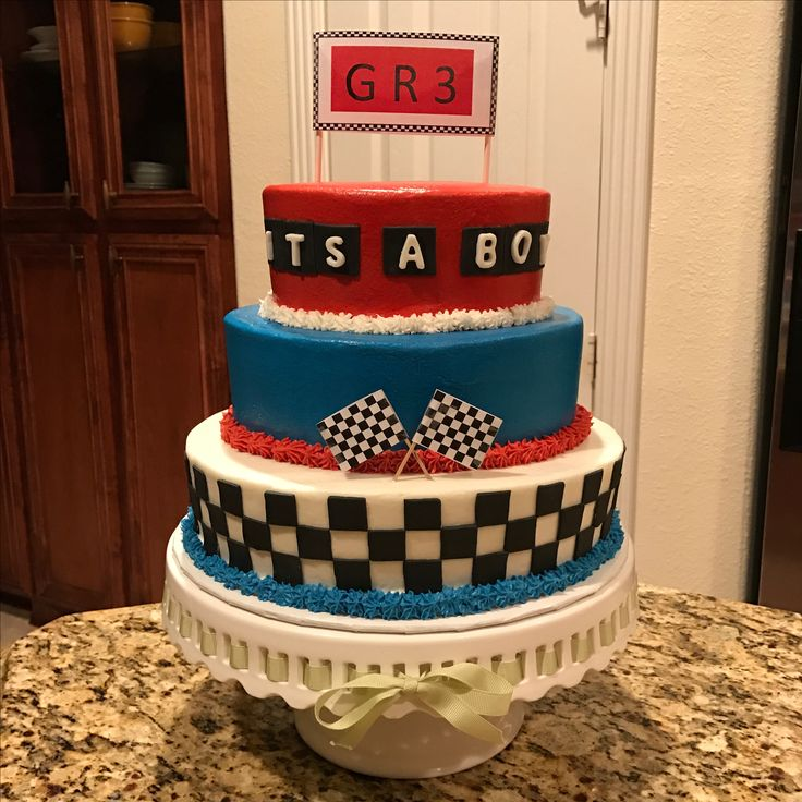 Race car theme baby shower cake.  https://www.facebook.com/sweetnsassycakesbyeva