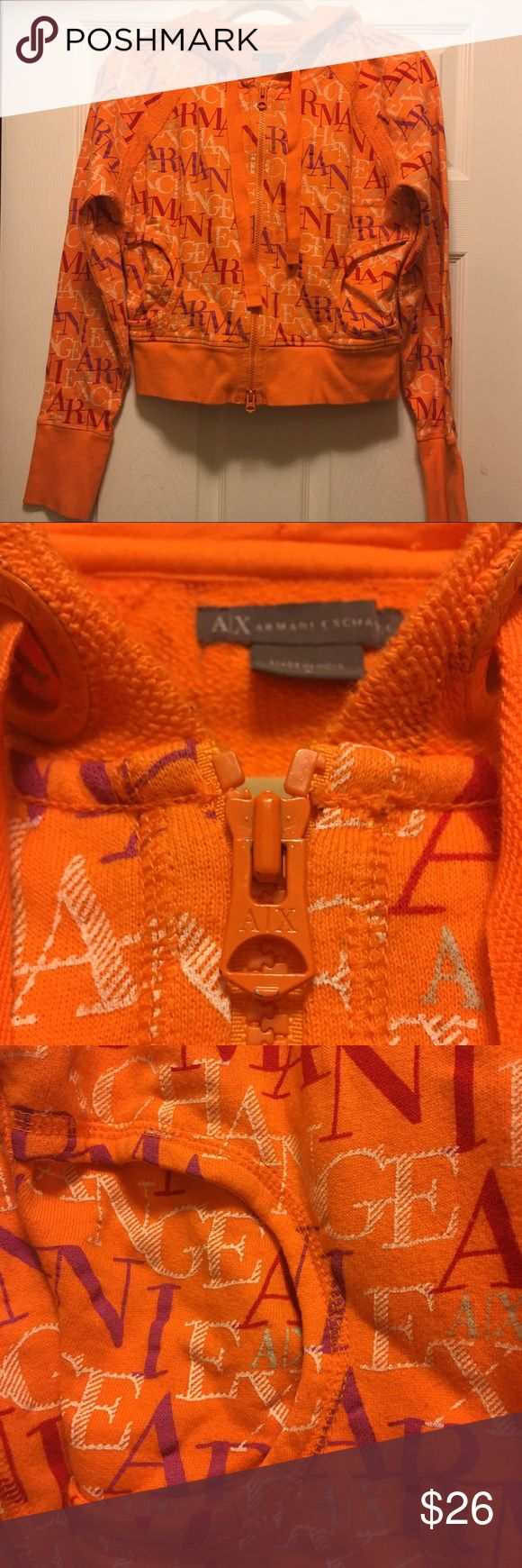 Armani Zip up hoodie Orange zip up hoodie, crop, with Armani in red white and purple colors. Size Large Worn a few times Great condition, a very tiny amount of orange rubbed off zipper, shown in picture.  Otherwise excellent condition. Armani Exchange Jackets & Coats Utility Jackets