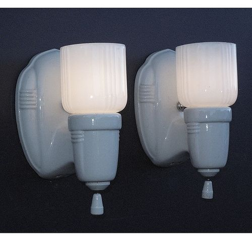 These vintage bathroom or vintage kitchen wall lighting sconces are classic 1920s -1930s decor. White porcelain lamps with period white shades  http://www.vintagelights.com/product/4/vintage-white-porcelain-bathroom-kitchen-sconces-with-period-shades.html