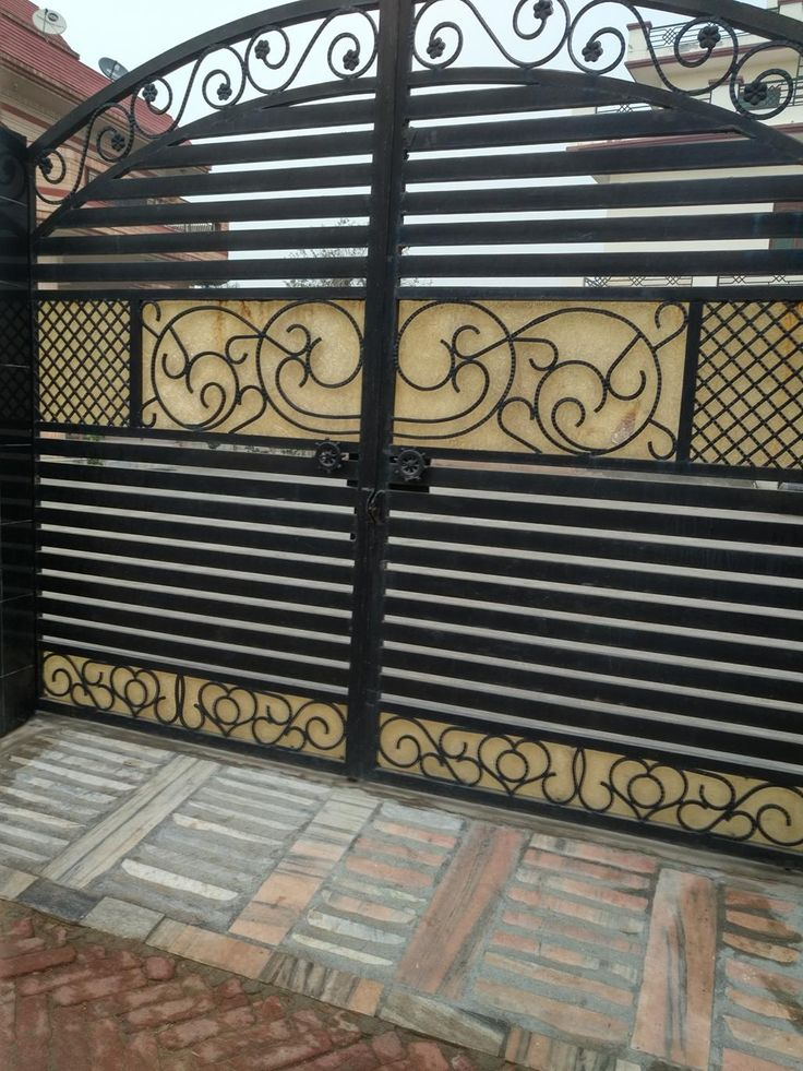 Beautiful looking front door gate for security around this house.