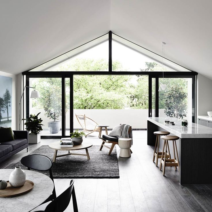 All the spaces and rooms (Living, Dining and Kitchen) flow together without walls and then connect to the outside space with large open doors that brings the outdoor elements into the interior spaces.