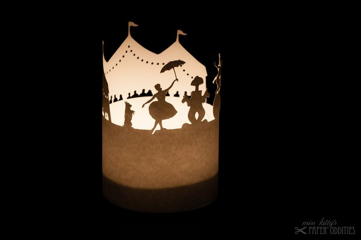 construction paper for a little lantern. circus scenery with a clown and artists.