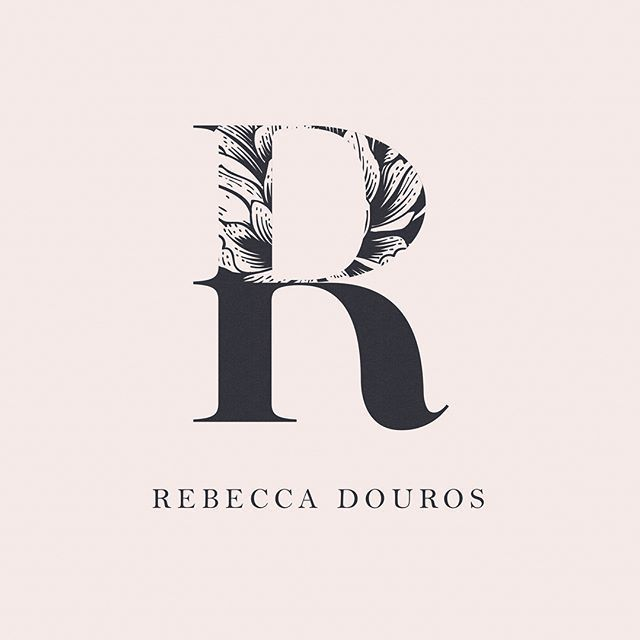 beautiful sophisticated and feminine logo design with bold letter and gorgeous typography especially love how the floral illustration is incorporated into