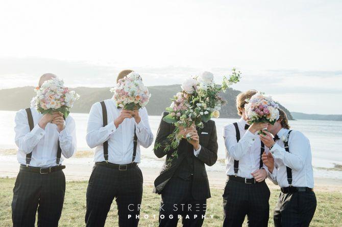 Groom and groomsmen with flowers #wedding #groomsmen #flowers