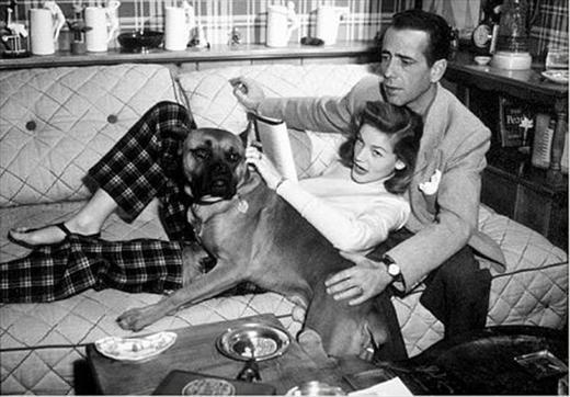 Humphrey Bogart and Lauren Bacall with their pet boxer at home, circa 1945...Old Hollywood.: