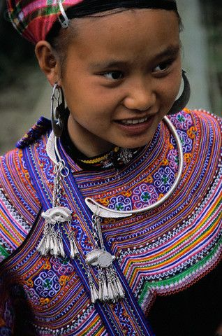 Vietnam | A Yao girl in Bac Ha, Vietnam, wears aluminium jewelry with an elaborately embroidered top. Vietnam's Yao minority live in the country's mountain regions and are known for their brightly colored outfits. | © Robert van der Hilst/Corbis