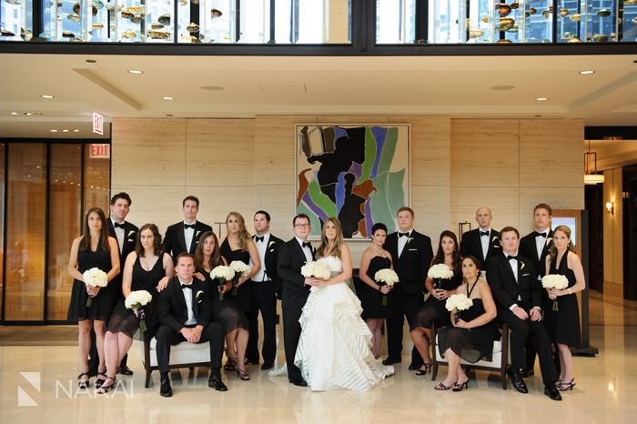 Chicago wedding photo at Langham Hotel - Bridesmaids in black dresses - Groomsmen in black tie tuxedo - White rose bouquets - Bridal Party wedding picture by Chicago wedding photographer: Nakai Photography http://www.nakaiphotography.com