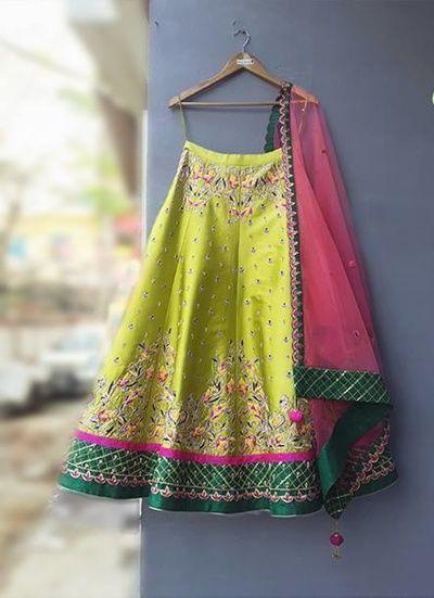 Light Lehengas - Green SIlk Lehenga | WedMeGood | Green Lehenga with Dark Geen and Pink Detailing and Net Pink Dupatta #wedmegood #indianbride #indianwedding #lehenga #brightgreen #pink #bridal