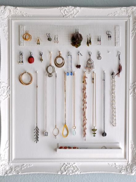 Think your gems are picture perfect? Remodel a frame to show off your works of art. Board up a frame back, add a few eyehooks and attach a homemade drawer (this one's made from scrap molding) to show off your adornments.