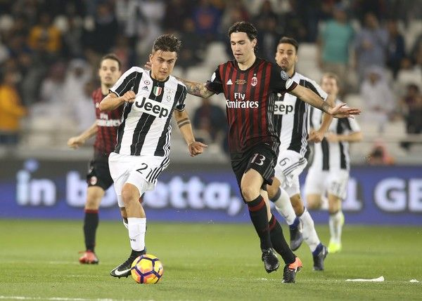 Paulo Dybala  of Juventus FC in action against Alessio Romagnoli of AC Milan during the Supercoppa TIM Doha 2016 match between Juventus FC and AC Milan at the Jassim Bin Hamad Stadium on December 23, 2016 in Doha, Qatar.