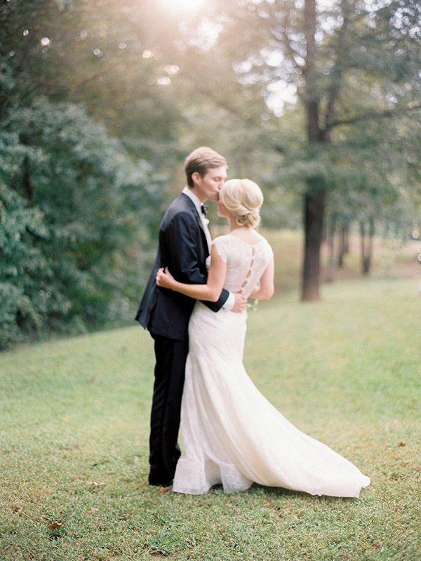 We love this bride's elegant lace gown and classic bridal updo! Photo: Lauren Kinsey / Event Planning & Design: Jessica Sloane