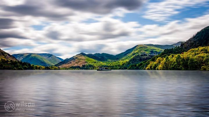 Ferry Stop. In the English #LakeDistrict lies #Ullswater one of my favourite places to be. Even such a large body of water can be calm at the right time and lounging around the shores on a nice day is serenity itself. An early morning saw us hanging around the shores looking for a shot. A lake ferry possibly one of the #UllswaterSteamers politely posed for us a way up the lake. If you know the name of the vessel then please tell Already setup for a long exposure I was hesitant as I thought…